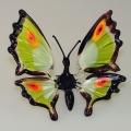 Schmetterling stehend, grün mit Pfauenaugen