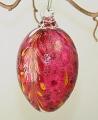 Osterei rubinrot mit farb. Einschmelzungen und Glasöse